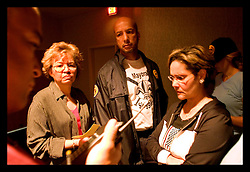29th August, 2005. Hurricane Katrina hits New Orleans, Louisiana. Mayor Ray Nagin and top city councillors listen to the latest reports coming in on the emergency services radio.