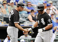 SURPRISE, AZ - MARCH 06:  Jose Abreu #79 of the Chicago White Sox is greeted by third base coach Joel Skinner after hitting a two-run home run, his first as a member of the Chicago White Sox,  against the Kansas City Royals on March 6, 2014 at The Ballpark in Surprise in Surprise, Arizona. (Photo by Ron Vesely)   Subject: Jose Abreu; Joel Skinner