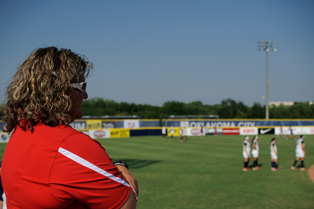 (photo by Matt Roth).Thursday, June 28, 2012..Former Team USA catcher and Softball Factory Director of Operations Lea Ann Jarvis throws out the first pitch during the Softball Factory World Cup game when Team USA played Puerto Rico play at the ASA Hall of Fame Stadium.