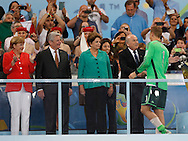 Germany's Manuel Neuer shakes hands with FIFA President Sepp Blatter as Brazilain President Dilma Rousseff (centre) and German Chancellor Angela Merkel wait to talk with him during the 2014 FIFA World Cup Final match at Maracana Stadium, Rio de Janeiro<br /> Picture by Andrew Tobin/Focus Images Ltd +44 7710 761829<br /> 13/07/2014