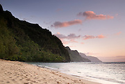 Ke'e Beach on the north shore of Kauai leads to the lush green cliffs of the Na Pali coast.