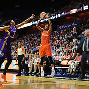 UNCASVILLE, CONNECTICUT- JULY 15:  Courtney Williams #10 of the Connecticut Sun shoots for three as Candace Parker #3 of the Los Angeles Sparks defends during the Los Angeles Sparks Vs Connecticut Sun, WNBA regular season game at Mohegan Sun Arena on July 15, 2016 in Uncasville, Connecticut. (Photo by Tim Clayton/Corbis via Getty Images)