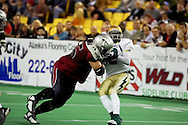 4/12/2007 - Frisco's Jamaal Denmon spins out of a tackle from Lokeni Lokeni, Jr. as the Thunder cruse to a 46-33 victory over the Alaska Wild in the first professional football game in Alaska.