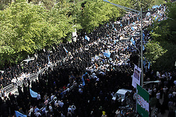 Oct. 4, 2015 - Tehran, iran - Iranians mourn during a funeral procession for some of the Iranian pilgrims who were killed in a stampede at the annual hajj on October 4, 2015 in the capital Tehran. Ceremonies took place across Iran to honour citizens killed at the hajj, as a second plane returned the bodies of 114 pilgrims from Saudi Arabia. 4 oct 2015, Tehran-Iran. (Credit Image: © Rouzbeh Fouladi/NurPhoto via ZUMA Press)