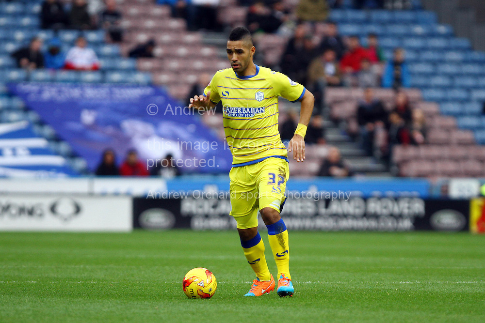 Lewis McGugan of Sheffield Wednesday in action. Skybet football league championship match, Huddersfield Town v Sheffield Wednesday at the John Smith's stadium in Huddersfield, Yorkshire on Saturday 22nd November 2014.<br /> pic by Chris Stading, Andrew Orchard sports photography.