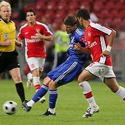 NLD/Amsterdam/20080808 - LG Tournament 2008 Amsterdam, Ajax v Arsenal, Klaas Jan Huntelaar in duel met Kolo Toure