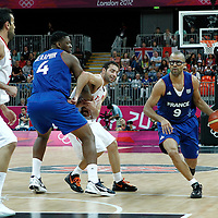 04 August 2012: France Tony Parker drives past Tunisia Marouan Laghnej on a screen set by Kevin Seraphin during 73-69 Team France victory over Team Tunisia, during the men's basketball preliminary, at the Basketball Arena, in London, Great Britain.