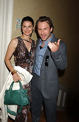 Actor CHRISTIAN SLATER and his wife RYAN HADDON at a party hosted by Dom Perignon and Vanity Fair magazine to celebrate the launch of a unique collection of essays based on the theme of seduction to raise money for the charity English Pen. The paty was held at the Dom Perignon Mallroom,  13 Grosvenor Crescent, London W1 on 8th September 2004.