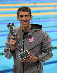 "USA's Michael Phelps with his award for ""The Greatest Olympic Athlete Of All Time"" after winning his 22nd Olympic Medal, which included 18 Gold Medals"