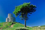 Adult climbing path to Saint Nicholas (Sveti Nikola) Church in the Prahulje field near Nin, Croatia