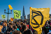 Southwark Bridge is blocked - Extinction Rebellion Day -  co hosted by Rising Up, 'Rebel Against the British Government For Criminal Inaction in the Face of Climate Change Catastrophe and Ecological Collapse'. A protest that involves blocking 5 bridges: Southwark, Blackfriars, Waterloo, Westminster and Lambeth.