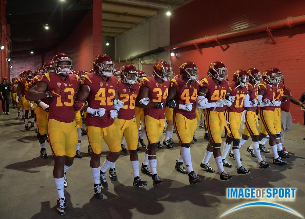 Sep 10, 2016; Los Angeles, CA, USA; USC Trojans players De'Quan Hampton (13), Uchenna Nwosu (42), James Toland IV (26), Olajuwan Tucker (34), Mali Dorton (44), Jabari Ruffin (40), receiver Darreus Rogers (1) and Nico Falah (74) walk through the Los Angeles Memorial Coliseum onto the field during a NCAA football game against the Utah State Aggies.