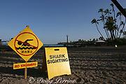 shark warning sign advises of closed beach due to shark attack (minor injuries) two days earlier, Kahaluu Beach, Kona, Hawaii, USA