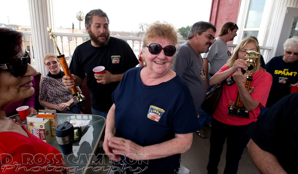Linda Allen, center, reacts to winning the top prize in the Spam cooking competition at the 14th annual Spam Festival, Sunday, Feb. 15, 2015 in Isleton, Calif. Allen's Spam biscuits and gravy beat out a field that included Spam chili, Spam cookies, Spam Benedict and Spam taffy. (Photo by D. Ross Cameron)