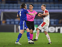 Football - 2020 / 2021 Europa League - Round of 32 - Second Leg - Leicester City vs Slavia Prague - King Power Stadium<br /> <br /> Referee Serdar Gozubuyuk (NED) separates Leicester City's Caglar Soyuncu and Slavia Prague's Jan Kuchta.<br /> <br /> COLORSPORT/ASHLEY WESTERN