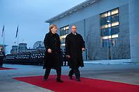 16 JAN 2009, BERLIN/GERMANY:<br /> Angela Merkel (L), Bundeskanzlerin, und Wladimir Putin (R), Ministerpraesident Russland, auf dem Weg ins Kanzleramt, nach einem Empfang mit militaerischen Ehren, Ehrenhof, Bundeskanzleramt<br /> IMAGE: 20090116-01-018<br /> KEYWORDS: Vladimir Putin