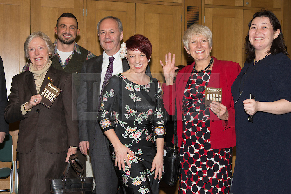 © Licensed to London News Pictures. 23/02/2015. London, England. L-R: Baroness Gloria Hooper, Robin Windsor, Frank Doran, Jenny Thomas, Angela Watkinson and Caroline Miller, Director of Dance UK. MPs attend a dance class with members of Dance UK and Lindy Hop dancers. Dance UK launches the 2015 Dance Manifesto with a beginners' social dance class hosted by the All Party Parliamentary Dance Group for all MPs at Portcullis House and led by teacher Jenny Thomas, charleston choreographer for the BBC's Strictly Come Dancing with Strictly professional dancer Robin Windsor. Photo credit: Bettina Strenske/LNP
