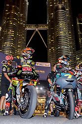 October 31, 2018 - Kuala Lumpur, Malaysia - Malaysian MotoGP rider Hafizh Syahrin (L) of Monster Yamaha Tech 3 and Malaysian Moto3 rider Adam Norrodin (R) of SIC Racing Team pose with their bikes in front of the Malaysia's landmark Kuala Lumpur twin tower in Kuala Lumpur, during a MotoGP pre-event ahead of Malaysian Grand Prix, on October 31, 2018. (Credit Image: © Zahim Mohd/NurPhoto via ZUMA Press)