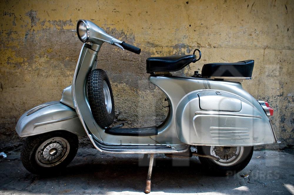 Vintage gray vespa parked in a street of Ho Chi Minh city, Vietnam, Asia