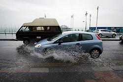 © London News Pictures. 23/09/2012. Brighton, UK.  A car driving through a rainwater covered road on Brighton seafornt on September 23, 2012. Photo credit : Ben Cawthra/LNP.