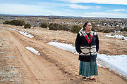 Denise Jensen, a teacher at at Navajo Preparatory School, stands for a portrait on a dirt road just outside of Farmington New Mexico.