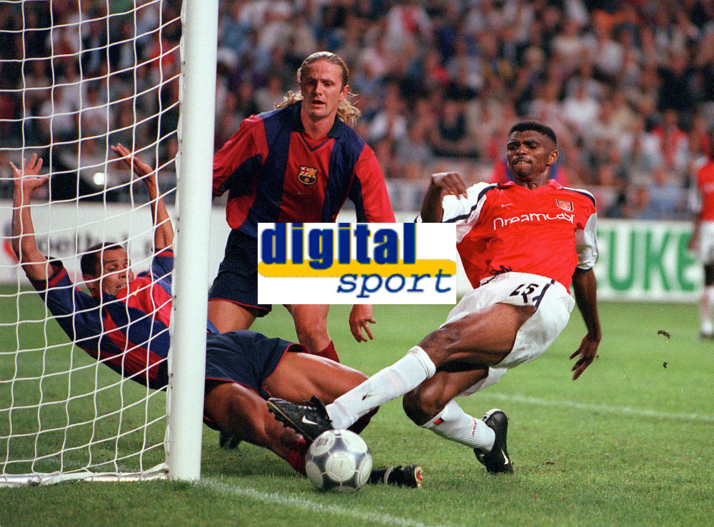 Kanu (Arsenal) dives at the ball as Rivaldo and Emmanuel Petit (Barcelona) close in. Arsenal v FC Barcelona, The Amsterdam Tournament, Amsterdam Arena, Holland, 3/8/2000. Credit Colorsport / Stuart MacFarlane.