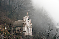 Italian chapel on Planica mountain (1376m), in low cloud, near the village of Dreznica, Alpe Adria Trail, Slovenia. The chapel was built in memory of the Italian soldiers who died on this front during the First World War. © Rudolf Abraham