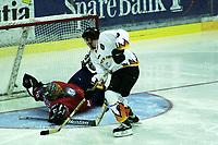 Icehockey. Qualification Olympic Games. Norway-Germany 8 january 2001. Norge-Tyskland, Jordal Amfi. Thomas Greilinger, Germany, and Bjorge Josefsen, Norway.