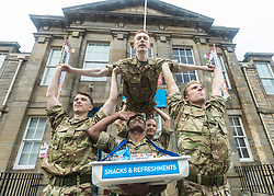 Brigadier Gary Deakin CBE welcomes performers to the Army reserve centre at Hepburn House for the opening of the Army's first ever Edinburgh Festival Fringe venue.<br /> <br /> Pictured: Performers from the Rosie Kay Dance Company production of 5 Soldiers with Corporal Raju Latianara from the 6 Scots Regiment