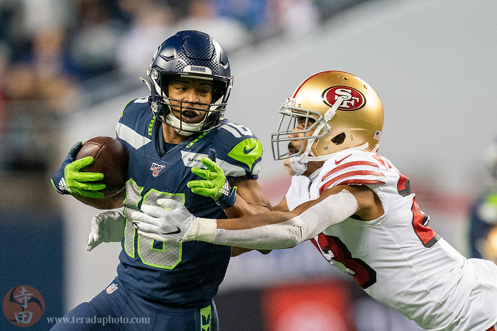 December 29, 2019; Seattle, Washington, USA; Seattle Seahawks wide receiver Tyler Lockett (16) runs against San Francisco 49ers cornerback Ahkello Witherspoon (23) during the second quarter at CenturyLink Field.