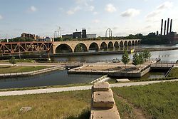 Minnesota, Twin Cities, Minneapolis-Saint Paul: Stone Arch Bridge crosses Mississippi at Minneapolis.  Former railroad bridge now used for recreation.  Stone Arch Bridge and Mill Ruins Park. .Photo mnqual261-74902..Photo copyright Lee Foster, www.fostertravel.com, 510-549-2202, lee@fostertravel.com.