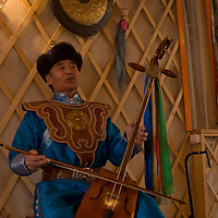 Mongolian musician Tserendorj sings and plays a traditional horsehead fiddle in his home in Ulaanbaatar, which he has decorated to look like a ger (yurt).