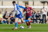 Ipswich Town midfielder Gwion Edwards (7) attacks Bristol Rovers defender Cian Harris (25) during the EFL Sky Bet League 1 match between Bristol Rovers and Ipswich Town at the Memorial Stadium, Bristol, England on 19 September 2020.