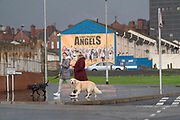Angels. A staunch unionist area. Shankhill Road estate, Belfast. It is a staunch unionist area, fiercely pro-Britain. Their representatives, the Democratic Unionist Party, founded by Ian Paisley in 1971, are presently in parliament in collusion with the conservative party, looking for a hard Brexit with a border between Northern Ireland and the South. The ten DUP votes gives the conservative party its majority in government. This is nothing new. During the 'Troubles' three decades of bloodshed, with Catholic Irish Republican Nationalists seeking to unit Ireland, the pro-British Protestant loyalists wanted to remain part of the United Kingdom