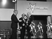 """B.O.I. GAA Allstars  (R96)..1989..03.02.1989..02.03.1989..3rd February 1989..The Awardsfor the B.O.I.Allstars were held tonight in the Burlington Hotel,Dublin. The list of the winnersis as follows..1989 - HURLING ALL STARS J. Commins (Galway), A. Fogarty (Offaly), E. Cleary (Wexford), D. Donnelly (Antrim), Conal Bonnar (Tipperary), B. Ryan (Tipperary), S. Treacy (Galway), M. Coleman (Galway), D. Carr (Tipperary), E. Ryan (Galway), Joe Cooney (Galway), O. McFetridge (Antrim), P Fox (Tipperary), Cormac Bonnar (Tipperary), N. English (Tipperary)."""" 1989 - FOOTBALL ALL STARS Gabriel Irwin (Mayo), Jimmy Browne (Mayo), Gerry Hargan (Dublin), Dermot Flanagan (Mayo); Connie Murphy (Kerry), Conor Counihan (Cork), Anthony Davis (Cork); Teddy McCarthy (Cork), Willie Joe Padden (Mayo); Dave Barry (Cork) Larry Tompkins (Cork), Noel Durkin (Mayo); Paul McGrath (Cork), Eugene McKenna (Tyrone), Tony McManus (Roscommon).""""..Image shows Kevin Armstrong receiving his award as all time football allstar. John Dowling, President of the GAA is presenting the award as An Taoiseach, Charles Haughey and Frank O'Rourke, Deputy Chief Executive, Bank of Ireland look on."""