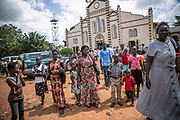 Aneno Margaret, center, leaves the catholic church after a mass in Gulu. She was abducted at the age of 11 in Acholi-bur village and was assigned to a commander two years later who had 13 wives. She also started a military training at that time and spent eight years as a soldier. She gave birth to two daughters in the bush. When she was 19 years old, a mortar attack at the frontline hit her arm and the chest, resulting in the amputation of one arm.