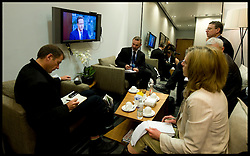 The core pool of reporters watch the Leader of the Conservative Party David Cameron on the Andrew Marr show at Heathrow airport as they wait to fly to Chester, Sunday May 2, 2010. Photo By Andrew Parsons / i-Images.