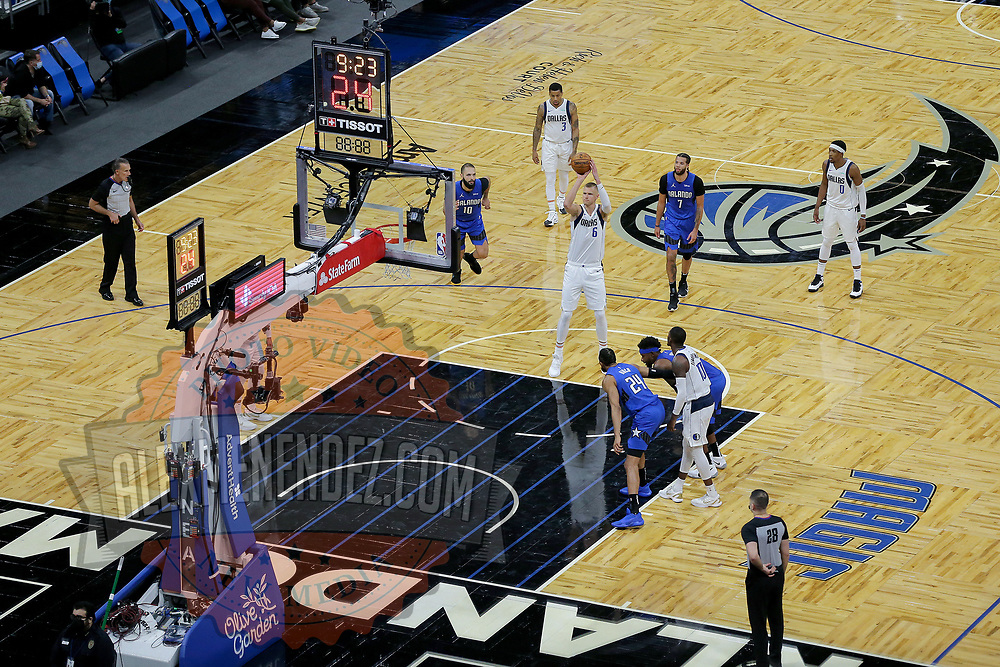 ORLANDO, FL - MARCH 01: Kristaps Porzingis #6 of the Dallas Mavericks attempts a free throw against the Orlando Magic at Amway Center on March 1, 2021 in Orlando, Florida. NOTE TO USER: User expressly acknowledges and agrees that, by downloading and or using this photograph, User is consenting to the terms and conditions of the Getty Images License Agreement. (Photo by Alex Menendez/Getty Images)*** Local Caption ***Kristaps Porzingis