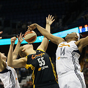 Theresa Plaisance, (centre), Tulsa Shock, is blocked by Kelsey Bone (right), Connecticut Sun, during the Connecticut Sun Vs Tulsa Shock WNBA regular season game at Mohegan Sun Arena, Uncasville, Connecticut, USA. 3rd July 2014. Photo Tim Clayton