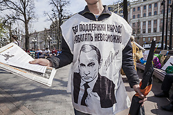 May 5, 2018 - Moscow, Moscow, Russia - A man wears a shirt with the face of Putin during a demonstration against Putin in Moscow, Russia. (Credit Image: © Celestino Arce via ZUMA Wire)