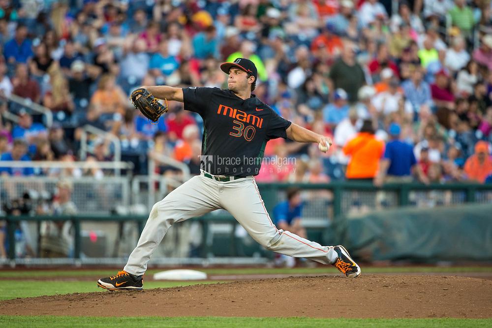 Andrew Suarez (30) of the Miami Hurricanes pitches during a game between the Miami Hurricanes and Florida Gators at TD Ameritrade Park on June 13, 2015 in Omaha, Nebraska. (Brace Hemmelgarn)