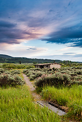 A settlers cabin at sunset.  The Cunningham Cabin was built in 1885, it features dirt floors, as sod-roof and a near by stream for water.  The view is to die for (not shown) of the Grand Teton Range in Jackson Hole.