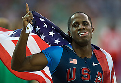 Dwight Phillips of United States celebrates winning the gold medal in the men's Long Jump Final during day eight of the 12th IAAF World Athletics Championships at the Olympic Stadium on August 22, 2009 in Berlin, Germany. (Photo by Vid Ponikvar / Sportida)