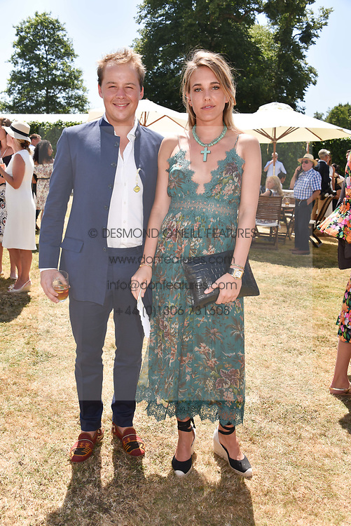 Luke Stopford Sackville and Daisy Knatchbull at the 'Cartier Style et Luxe' enclosure during the Goodwood Festival of Speed, Goodwood House, West Sussex, England. 15 July 2018.