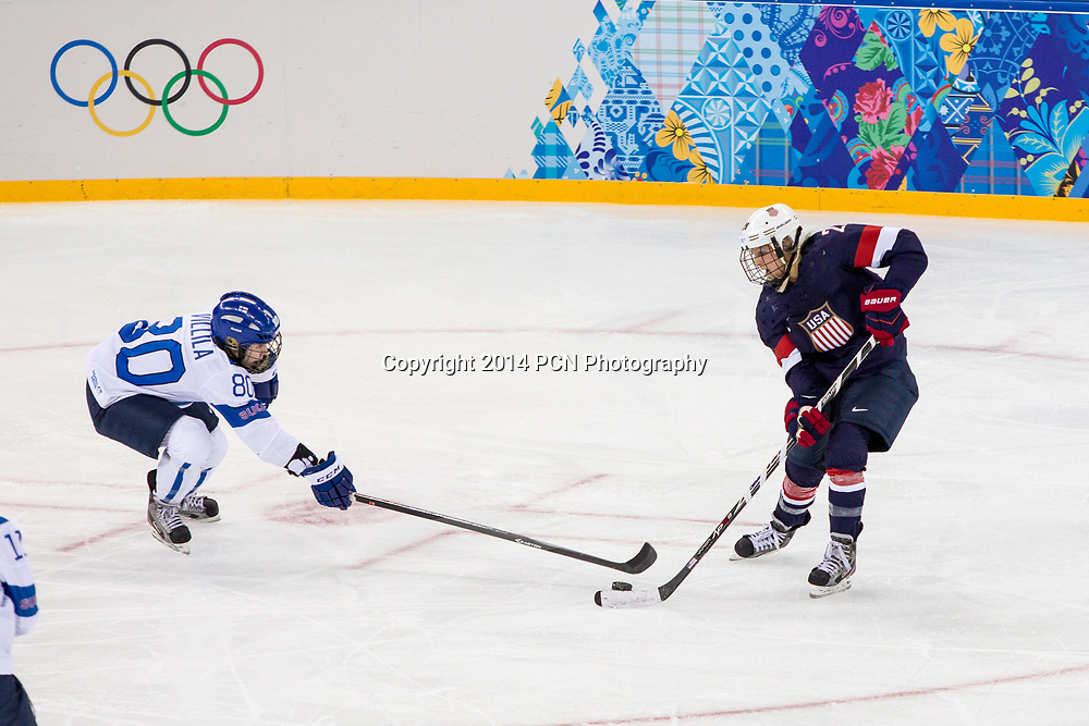 Venia Hovi (FIN) and Amanda Kessel (USA) during ice hockey game at the Olympic Winter Games, Sochi 2014
