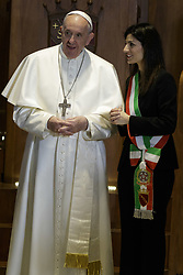 March 26, 2019 - Rome, Latium, Italy - Pope Francis speaks with Rome's Mayor Virginia Raggi (R) in the Julius Caesar Hall during his visit to the Campidoglio, Capitol Hill in Rome, Italy on March 26, 2019. (Credit Image: © Giuseppe Ciccia/Pacific Press via ZUMA Wire)