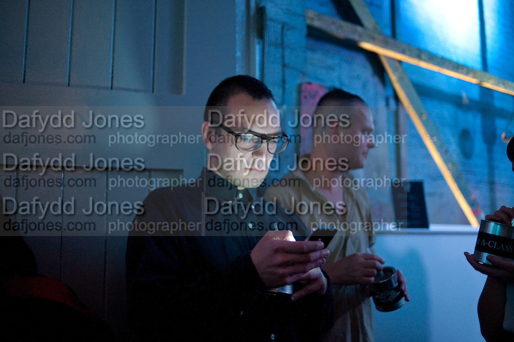 DARYOUSH HAJ-NAJAFI, Giles Deacon after-show party. Elm lester painting rooms. Leicester Sq. London. 19 September 2011. <br /> <br />  , -DO NOT ARCHIVE-© Copyright Photograph by Dafydd Jones. 248 Clapham Rd. London SW9 0PZ. Tel 0207 820 0771. www.dafjones.com.