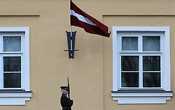January 2, 2018 - Riga, Latvia - The soldier of honor guard patrols near the residence of the President of Latvia against the background of the national flag of Latvia. Riga. Latvia, Tuesday, January 2, 2018  (Credit Image: © Danil Shamkin/NurPhoto via ZUMA Press)