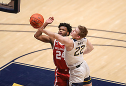 Feb 13, 2021; Morgantown, West Virginia, USA; West Virginia Mountaineers guard Sean McNeil (22) drives and shoots against Oklahoma Sooners guard Elijah Harkless (24) during overtime at WVU Coliseum. Mandatory Credit: Ben Queen-USA TODAY Sports