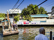 19 JANUARY 2015 - BANGKOK, THAILAND: The small ferry crosses Khlong Saen Saeb throughout the day. It is powered by an diesel engine that uses a system of cables to pull the ferry the 30 feet across the canal. It's used throughout the day by pedestrians  who need to get across the khlong.     PHOTO BY JACK KURTZ